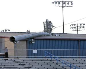 Light pole down at a stadium, apparently due to age